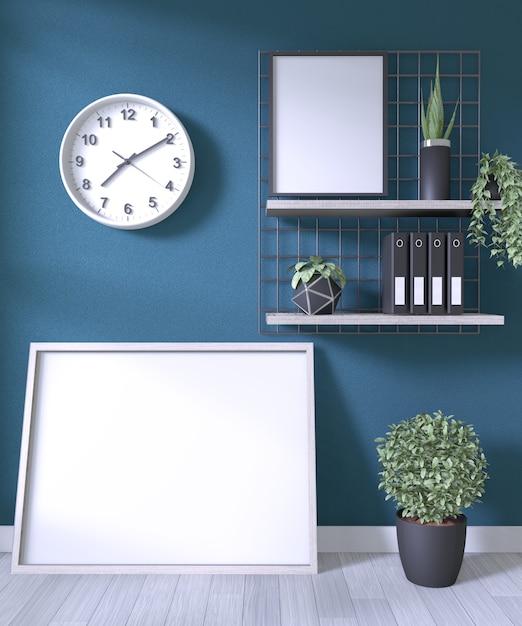 白い木製の床の部屋暗い壁にポスターフレームと装飾オフィスのモックアップします。 Premium写真
