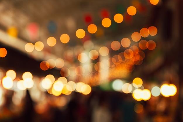 Ночной фестиваль света размытие фона Premium Фотографии