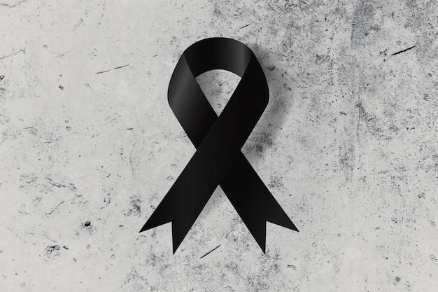 記憶または喪の記念の地上シンボルの黒いリボン Premium写真
