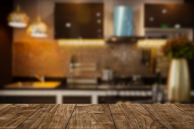 ディスプレイまたはモンタージュ製品の木製卓上スペースとモダンで豪華なキッチンブラックゴールデントーン。 Premium写真