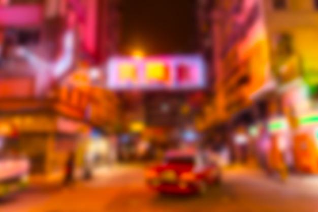 背景に香港の夜中華街カラフルなネオン旅行通りをぼかし Premium写真