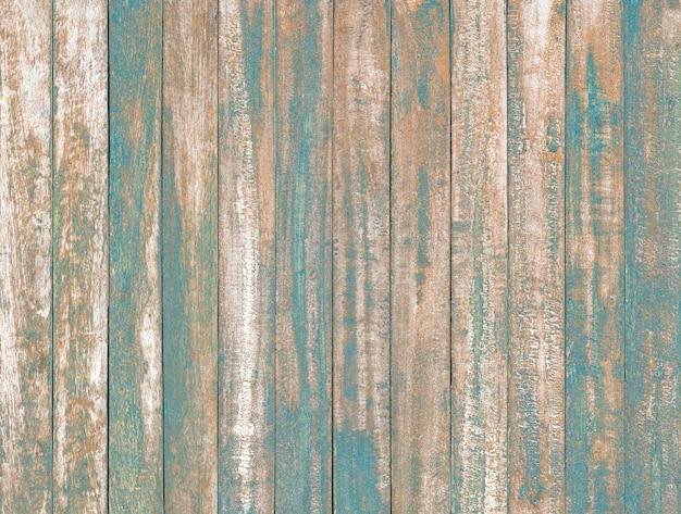 オーシャンブルー色のヴィンテージの木製テーブル背景テクスチャの塗料を剥離します。 Premium写真
