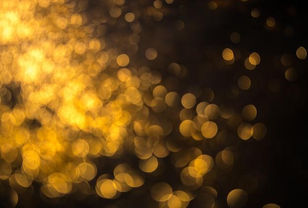 ボケ味を持つクリスマスの背景デフォーカスライト Premium写真