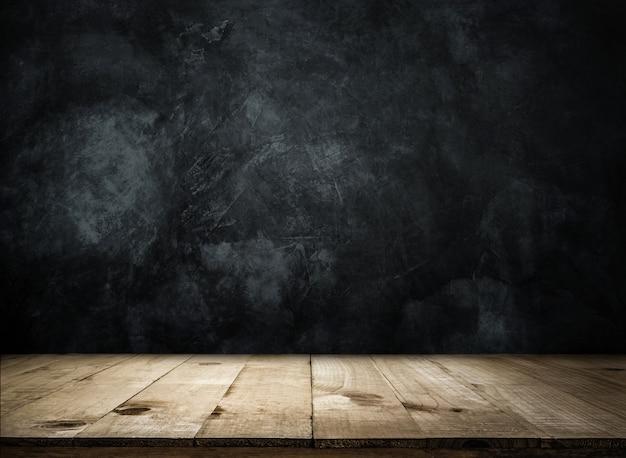 グランジの壁の上の空の木製テーブル製品の表示またはモンタージュの空の準備ができて。 Premium写真
