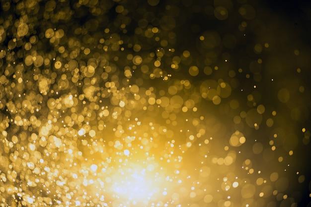クリスマスの背景。ボケ味を持つお祭りの抽象的な背景デフォーカスライトと星 Premium写真