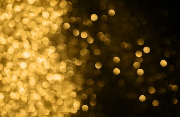 クリスマスの背景ボケ味とお祭りの抽象的な背景デフォーカスライトと星 Premium写真
