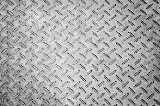 菱形のシームレスな金属のテクスチャ背景、アルミニウムまたはステンレスの暗いリスト Premium写真