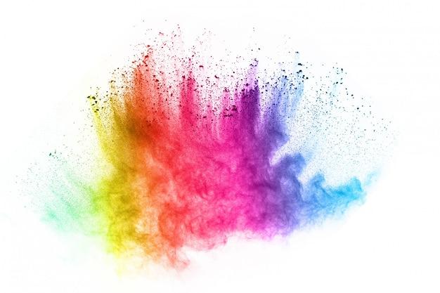 白い背景の上の多色粉体爆発。 Premium写真