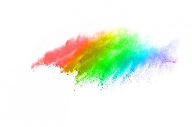 Красочный взрыв порошка на белой предпосылке. Premium Фотографии
