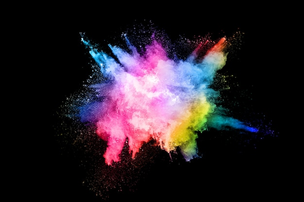 Абстрактный цветной взрыв пыли на черном фоне Premium Фотографии