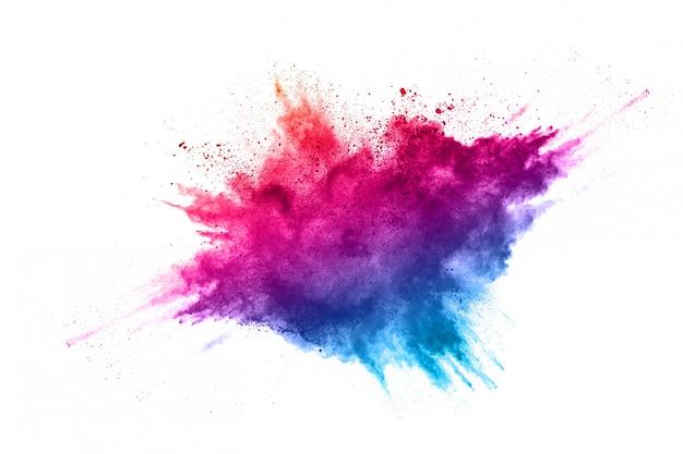 Красочный взрыв порошка на белом фоне Premium Фотографии