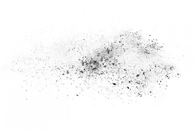 Взрыв черного порошка на белом фоне. Premium Фотографии