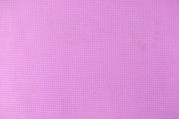 運動用のピンクのヨガマット Premium写真