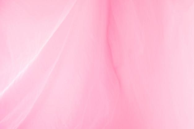 グラフィック広告を使用したい人のためのピンクの背景。 Premium写真