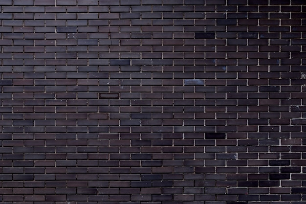 背景に使用して建設から汚れた灰色のレンガの壁のテクスチャ。 Premium写真