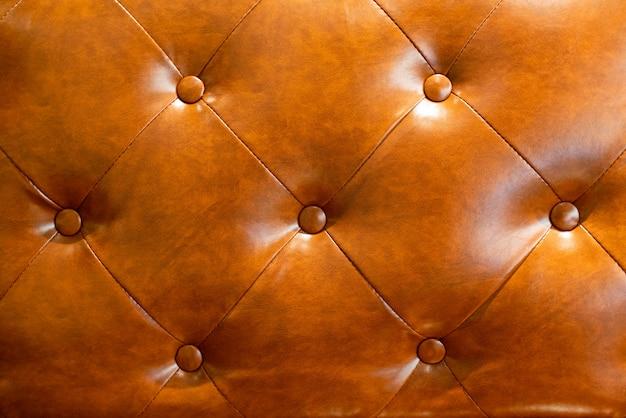 茶色の革のソファのテクスチャ背景。 Premium写真