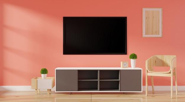キャビネットテレビ、ポスターフレームスタンド、床に空白のキャンバス Premium写真