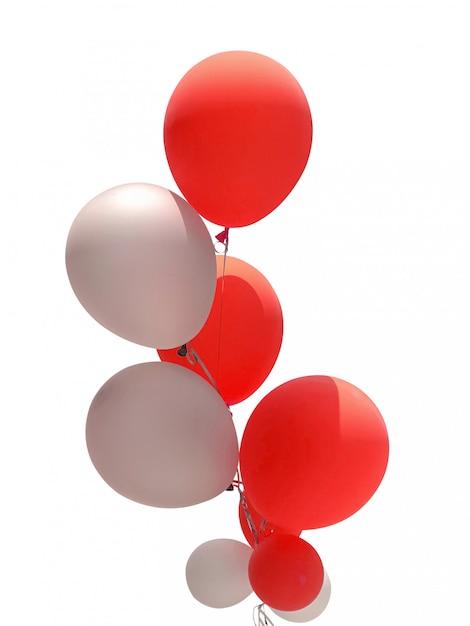白で隔離されるパーティーの装飾のための赤と白の風船のグループ Premium写真