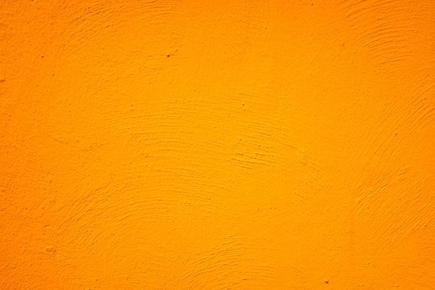 オレンジ色の塗られた壁の背景とテクスチャー。 Premium写真