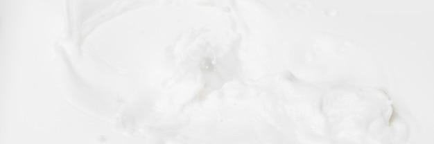 化粧品の白い抽象的な液体背景。 Premium写真