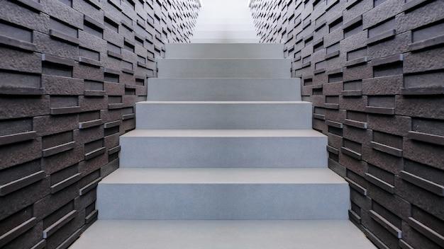 ロフトスタイルのモダンなデザインの屋外石造りの階段と壁のレンガ。 Premium写真