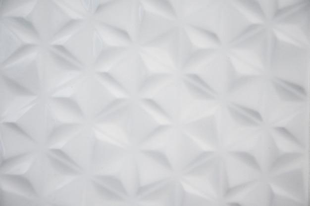 Белая предпосылка текстуры стены гипсолита. Premium Фотографии