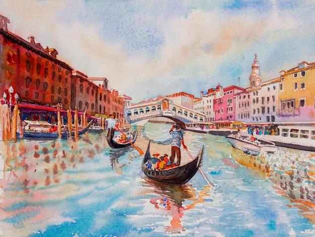 ゴンドラの観光客とヴェネツィアの運河 Premium写真