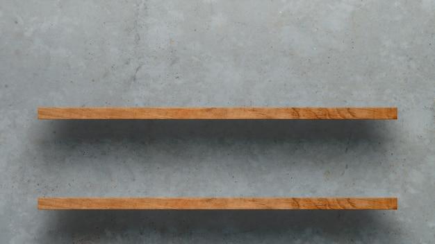 白いコンクリートの壁の背景の上の木製の棚 Premium写真