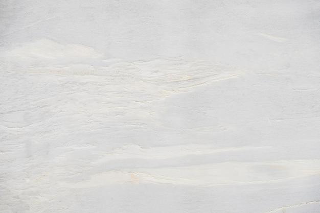 背景と背景のための美しい抽象的な白大理石の岩と石のデザインパターンを閉じます Premium写真