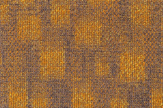 灰色がかったオレンジのカーペットの表面。 Premium写真