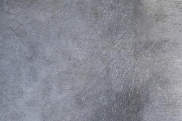 傷金属の質感、ブラッシュドスチールプレートの背景色 Premium写真