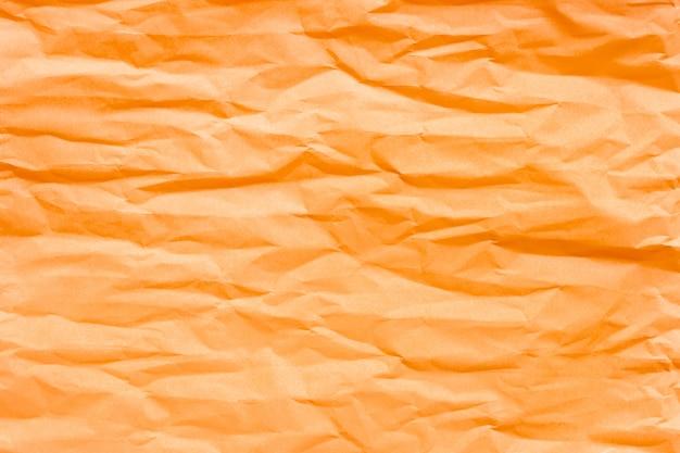 茶色のオレンジ色のしわくちゃの紙 Premium写真