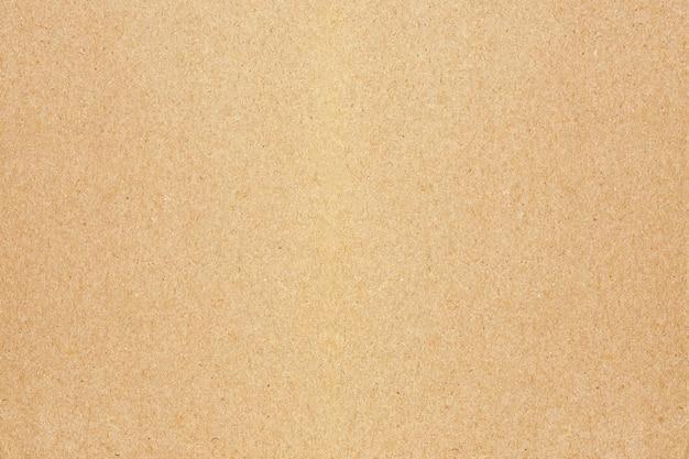 Коричневый фон текстуры бумаги. Premium Фотографии