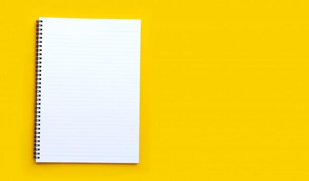 Дневник на синем фоне. вид сверху Premium Фотографии