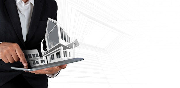 建築家またはデジタルタブレットと近代的な家の実業家 Premium写真