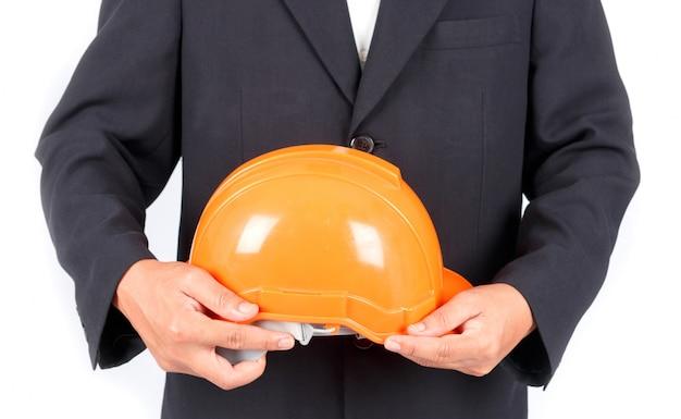 Бизнесмен с строительство шлем. изолированные на белом фоне Premium Фотографии