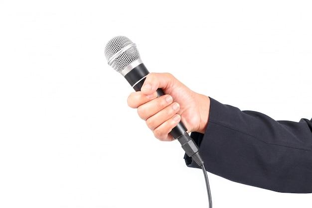 Деловой человек держит микрофон на белом фоне Premium Фотографии