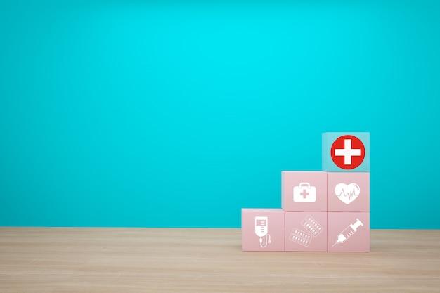 健康と医療保険の最小限のコンセプトアイデア、青色の背景に医療アイコンアイコンとスタッキングブロックの色を配置 Premium写真