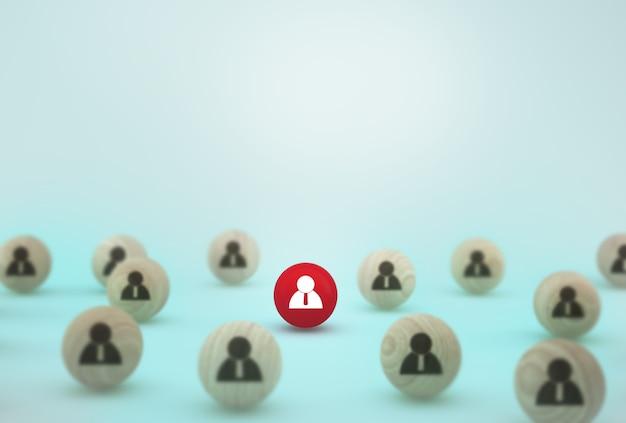 人的資源管理と採用ビジネスの従業員の概念の創造的なアイデア。青色の背景に木製の球体を配置 Premium写真