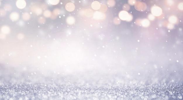 キラキラビンテージライトは、新年の休日の背景を抽象化します。青と金、コピースペース。 Premium写真