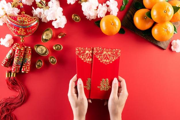 Китайский новый год фестиваль украшений на красном Premium Фотографии
