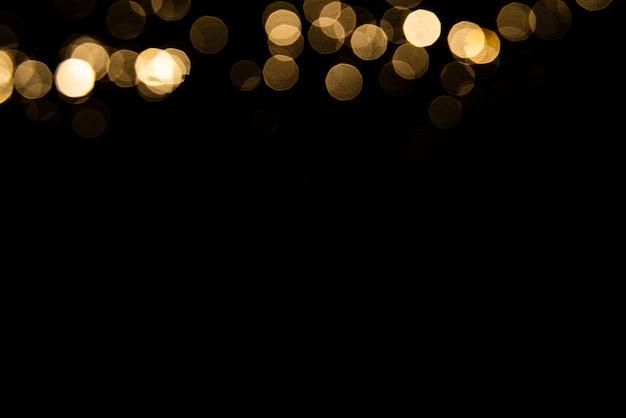 Абстрактный золотой боке с черным фоном Premium Фотографии