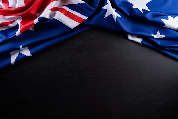 オーストラリアの日の概念。黒板背景にオーストラリアの旗 Premium写真