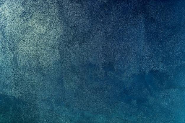 青のペイントの壁の背景のテクスチャ 無料写真
