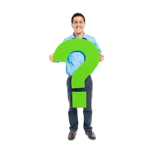 Умный случайный человек с зеленым вопросительным знаком Бесплатные Фотографии