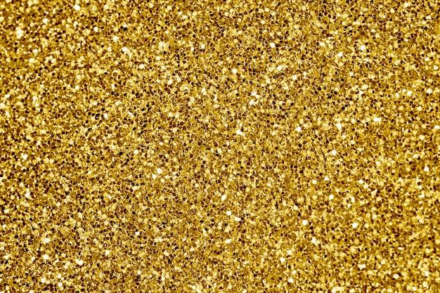 黄金の輝きのテクスチャ背景のクローズアップ 無料写真
