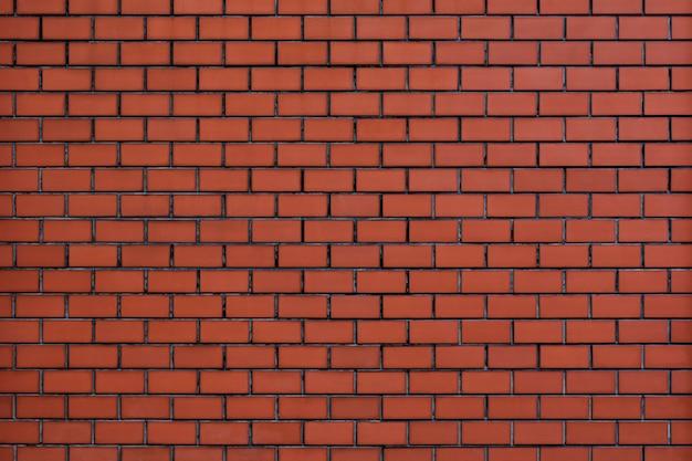 オレンジ色のレンガの壁のテクスチャ背景 無料写真