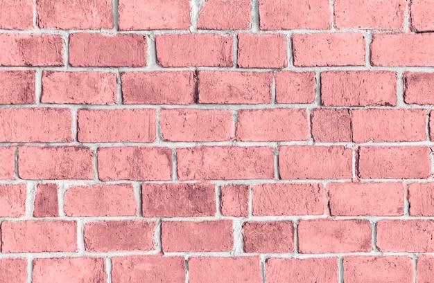 ピンクの質感のレンガの壁の背景 無料写真