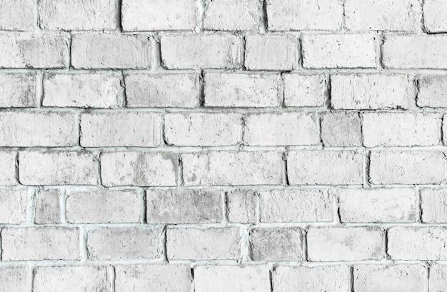 白い質感のレンガの壁の背景 無料写真