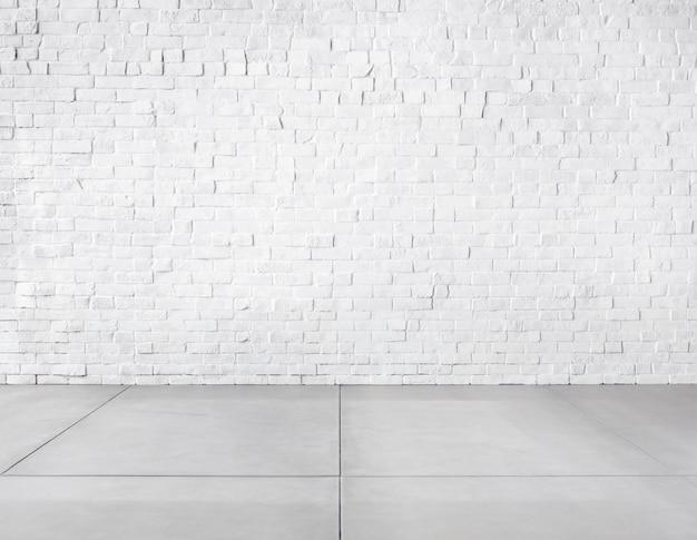 レンガの壁とコンクリートの床で作られた部屋 無料写真